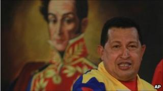 Hugo Chavez in front of a portrait of Simon Bolivar, 14 July 2010