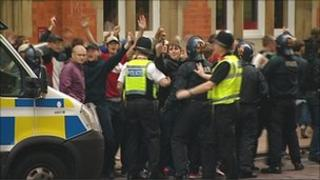 Police and football fans