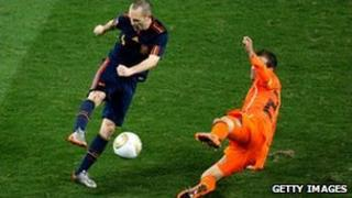 Andres Iniesta of Spain (left) scores the winning goal in the World Cup final, 11 July