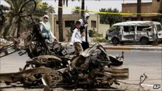 Wreckage of a car bomb attack in Baghdad last month