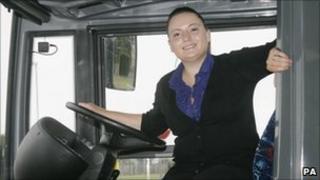 Louisa Burton driving a bus