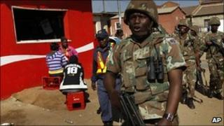 South African soldiers patrol the Diepsloot township north of Johannesburg, South Africa, Friday July 9 2010