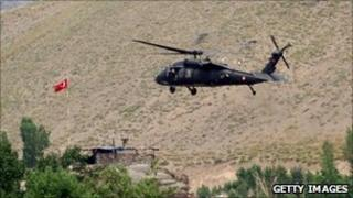 A helicopter from the Turkish security forces hovers a hill in Hakkari province, southeastern Turkey