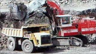 trucks loading stones