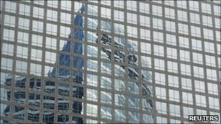 Goldman Sachs' headquarters reflected in a building in New York