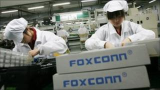Workers at a Foxconn factory in southern China - 5 July 2010