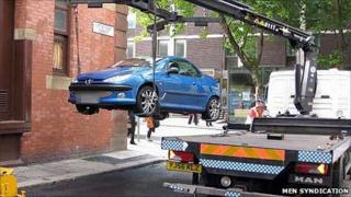 Car being hoisted in Manchester