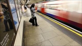 A passenger waits on a Tube platform