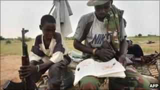 Jem rebel fighters studying before heading out on patrol - photographed at a base on 9 September 2004