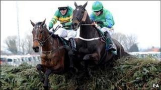 Don't Push It and Black Apalachi jump the last fence at the Grand National