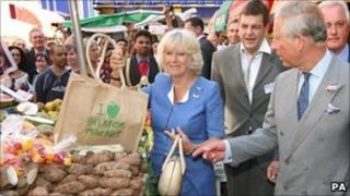 The Duchess of Cornwall and the Prince of Wales at Brixton Market in London
