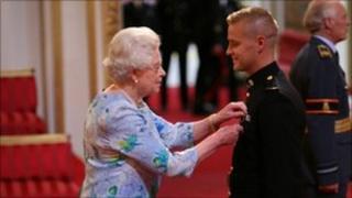 Michael Lockett receiving MC from the Queen
