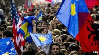 "Kosovans wave flags during ""independence day"" celebrations in Pristina in 2009"