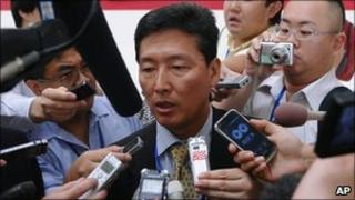 North Korean spokesman Ri Tong-il, centre, surrounded by journalists in Hanoi, Vietnam, 22 July 2010