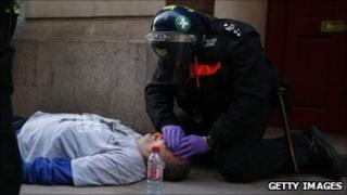 Ian Tomlinson being given treatment after collapsing at the G20