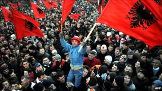 Photo taken on February 17, 2008 of Kosovars holding flags as they celebrate the independence of Kosovo in the capital Pristina