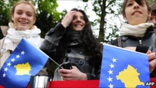 Girls holding Kosovo flags - file pic