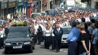 Many mourners wore the shirt of the local GAA team