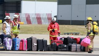 Firefighters inspect bags