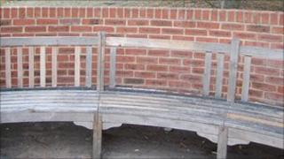 Damaged memorial bench in Staines