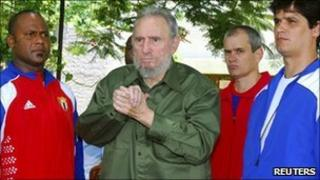 Fidel Castro, in green, at the Mausoleum of the Heroes of the Revolution in Artemisa outside Havana, Cuba, on 24 July, 2010