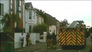Fire officers and police at the scene of the blaze