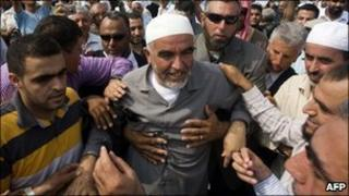 Raed Salah is surrounded by supporters as he arrives at Ramla prison near Tel Aviv on 25 July, 2010