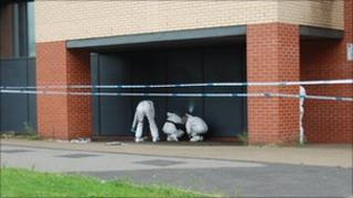 Forensic officers working at the scene in Chester Street