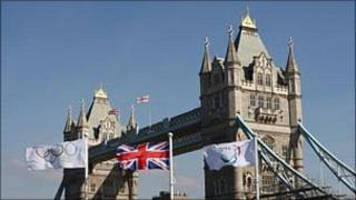 The Olympic, Union Jack and Paralympic flags fly in front of Tower Bridge in London