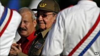 Raul Castro applauds during the Santa Clara rally