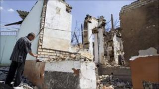 A man by the ruins of his house destroyed in ethnic violence in Osh (1 July 2010)