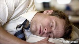 Man asleep in office (Posed by model)