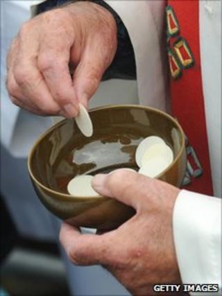 Priest with Communion wafer biscuits