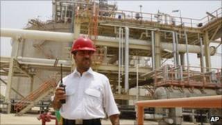 An Iranian worker walks in the South Pars gas field in Assalouyeh, Iran, July