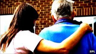 Older person with carer