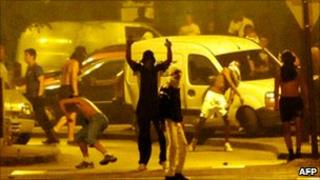 Youths face police during rioting in Grenoble