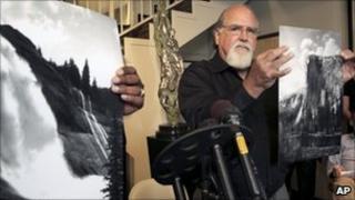 Rick Norsigian holding a photograph