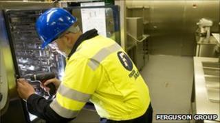 Ferguson Group technician at a galley unit