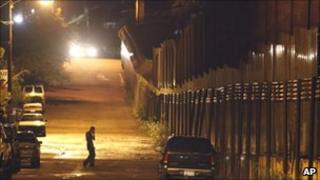 Man stands near the border with Mexico in Arizona