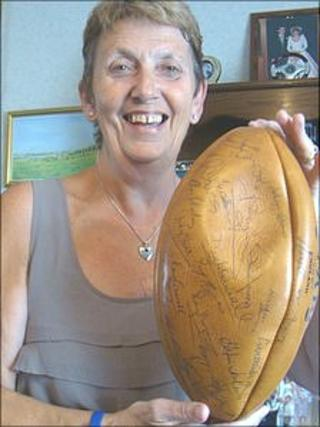 Margaret Richards with signed rugby ball