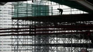 A construction worker works on the Aquatic Centre at the London 2012 Olympic site in Stratford, east London