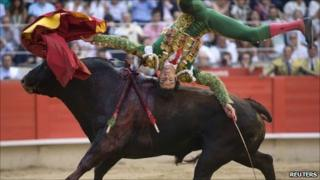Spanish bullfighter Jose Tomas is tossed by a bull during a bullfight in Barcelona - 5 July 2009
