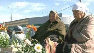 Russian pensioners sell flowers in Novosibirsk