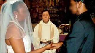 Brown carrying out a marriage ceremony