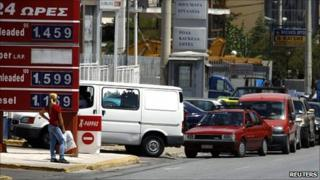 Cars line up outside a fuel station during a strike by truck drivers in Athens