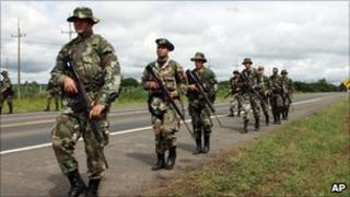 Soldiers on patrol in Paraguay in April 2010