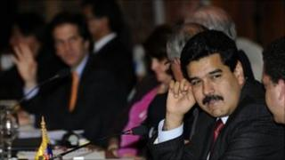 Nicolas Maduro (right) talks as Jaime, with Jaime Bermudez (left) in the background