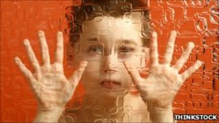 Autism - child behind glass - posed by model