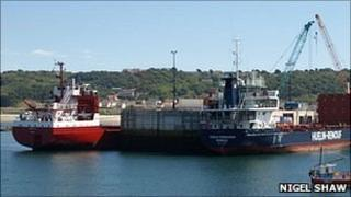 Two cargo ships berthed alongside the commercial quay at Braye Harbour
