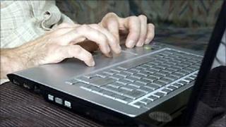Writing at laptop